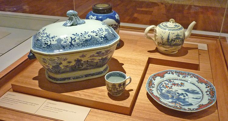 1.Tureen, with vase of flowers and balustrade design. 2.Coffee up, with pagoda design. 3. Octagonal plate, with fishing village design and applied decoration. 4.Teapot, dated with Chinoiserie design.