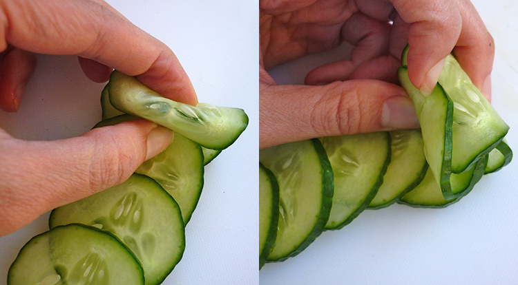 Cucumber flower with 12 petals, roll sliced cucumbers up step 1