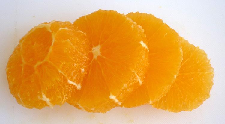Orange art, Orange chain, slicing orange and making hole in the center step 2