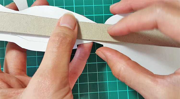 How to make a standing paper doll - stick cardboard behind