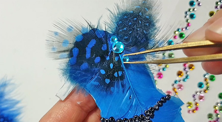 Decoration her with beads and gems